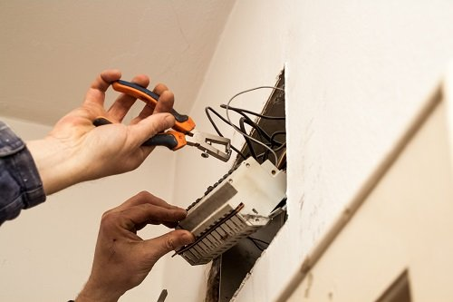 Why Electricians Recommend Replacing Old Wiring